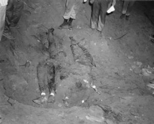 ** EDS NOTE GRAPHIC CONTENT ** FILE ** In this 1964 file photo released by the FBI, the bodies of three civil rights workers are uncovered from an earthen dam southwest of Philadelphia, Miss. The photograph was entered as evidence by the prosecution in the trial of Edgar Ray Killen, who was convicted in 2005 for three counts of manslaughter in the deaths of James Chaney, Andrew Goodman and Michael Schwerner. (AP Photo/FBI, File)